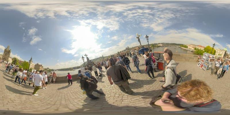 360VR Tourist crowds crossing Charles Bridge Prague Czech Republic royalty free stock photography