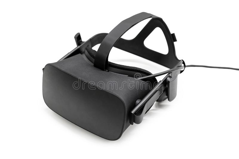 VR virtual reality headset half turned on white background. Gaming future device, virtual reality glasses. stock images
