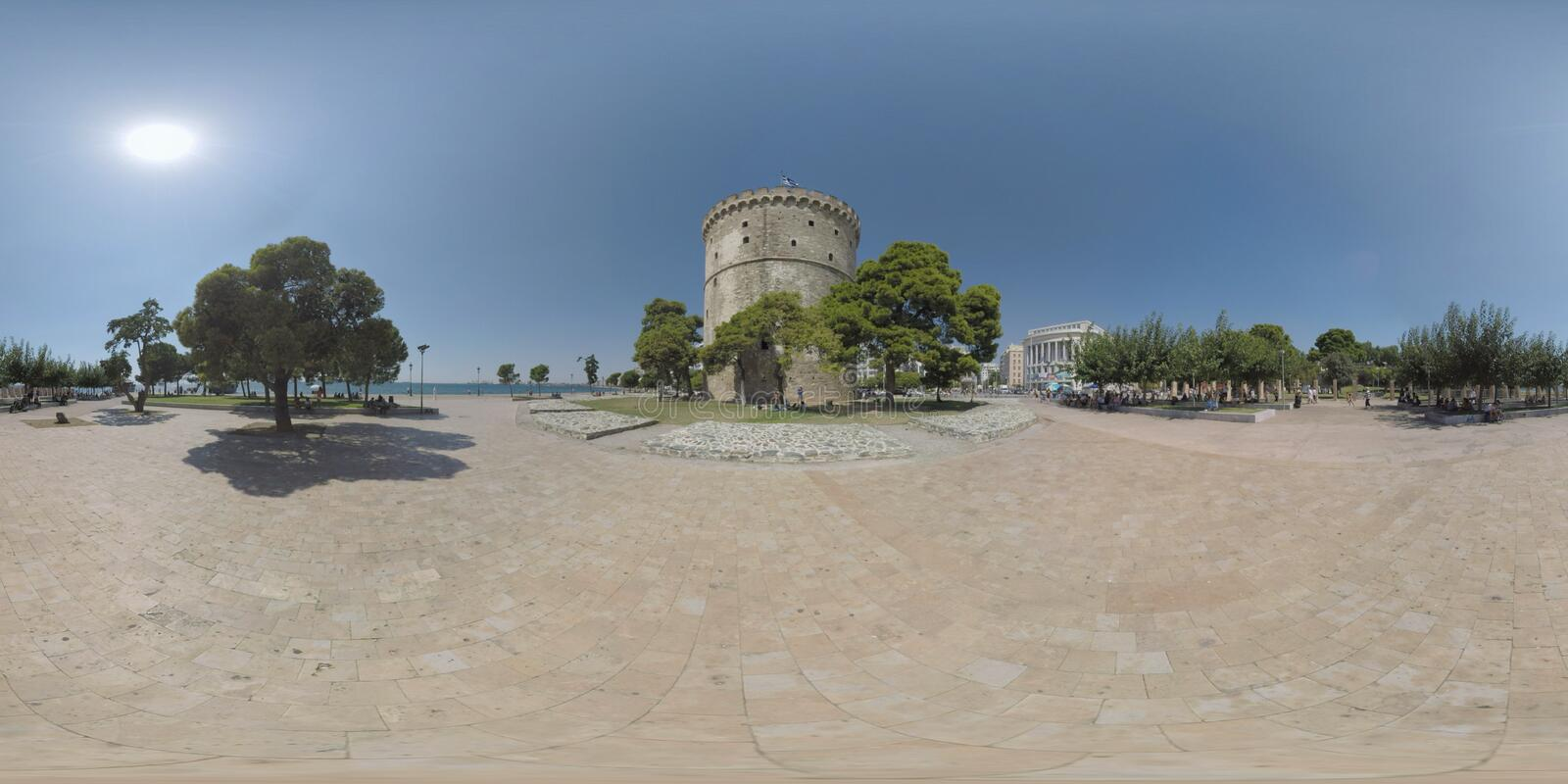 360 VR White Tower Square with people relaxing under the trees. Thessaloniki stock image