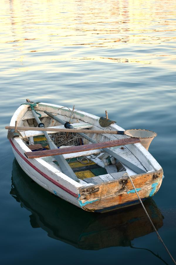 Old small wooden boat at sunset royalty free stock images
