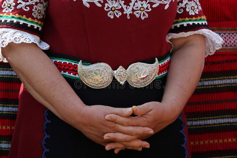 People in traditional authentic folk costumes on National folklore fair `Ledenika` stock images