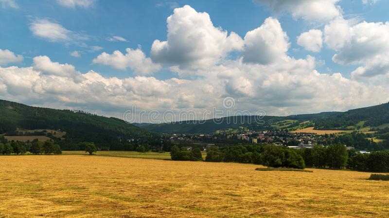 Vrbno pod Pradedem town with hilly surrouding in Czech republic. During nice summer day with blue sky and clouds royalty free stock photos