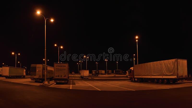 Vrbova Lhota, Czech republic - November 17, 2018: camions on parking lot of OMV filling station at night in day 29th anniversary. Of the Velvet Revolution 1989 stock photography