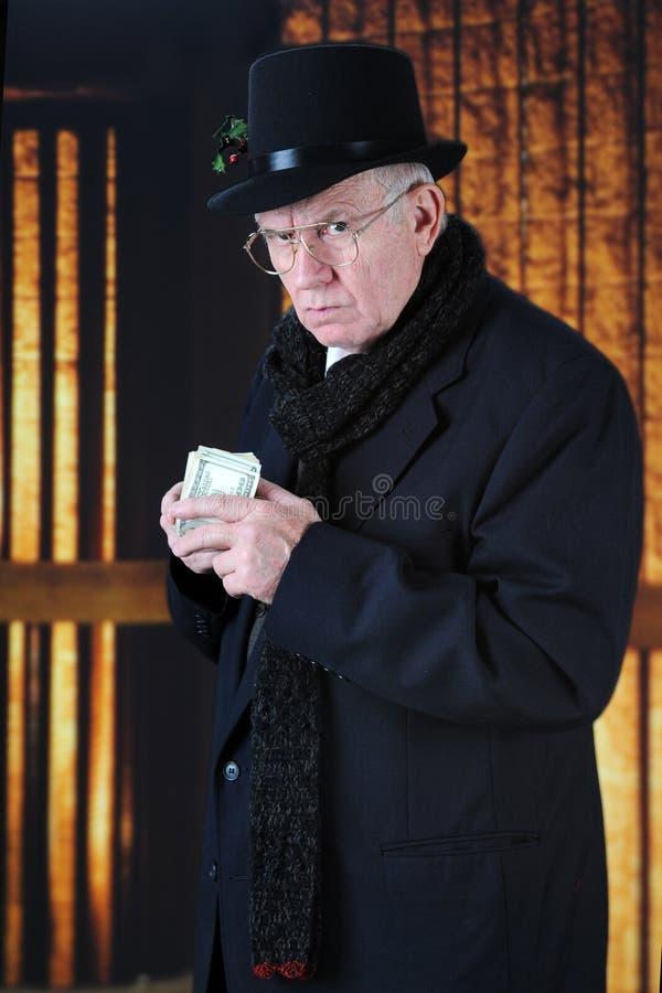 Vrek en Zijn Geld stock fotografie