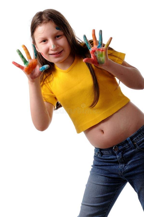 Vreugde. Het meisje van Preteen het spelen met kleuren royalty-vrije stock afbeeldingen
