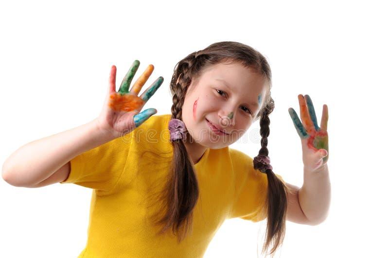 Vreugde. Het meisje van Preteen het spelen met kleuren royalty-vrije stock afbeelding