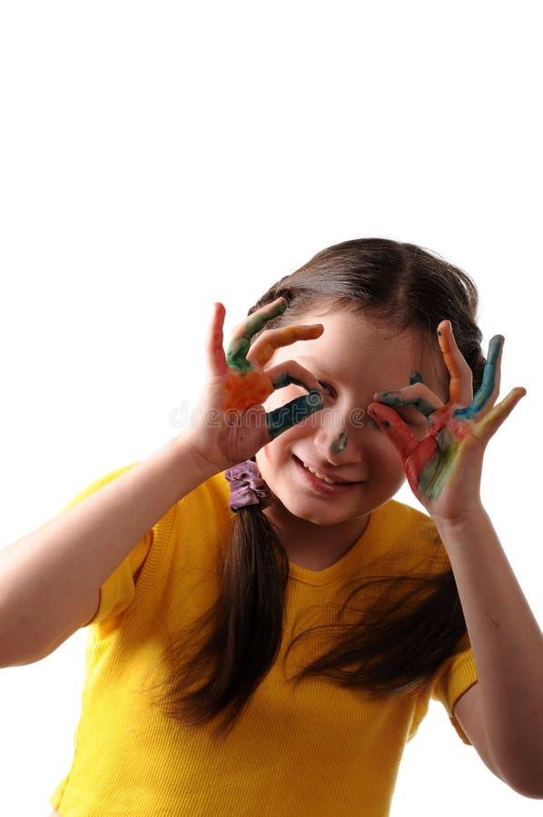 Vreugde. Het meisje van Preteen het spelen met kleuren stock foto
