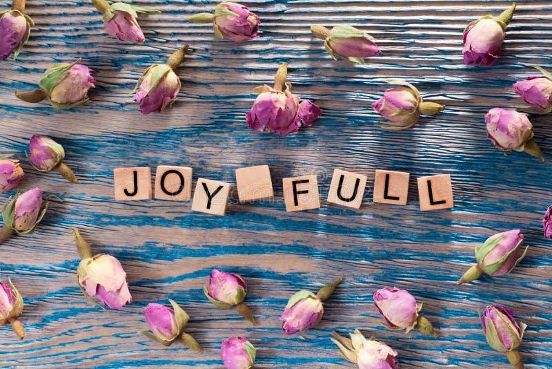 Vreugdehoogtepunt op houten kubus stock foto's