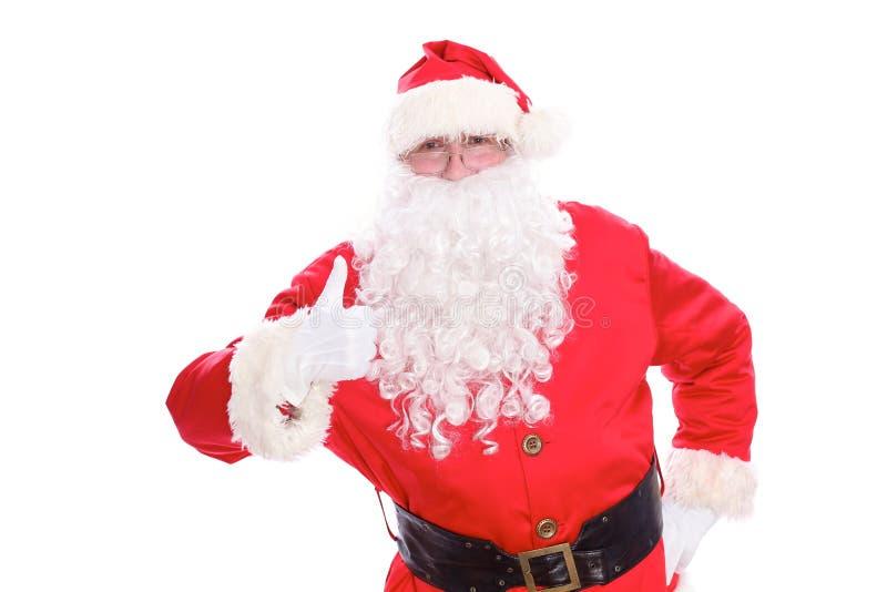Vriendelijke die Santa Claus-duim omhoog, op witte achtergrond wordt geïsoleerd royalty-vrije stock afbeeldingen