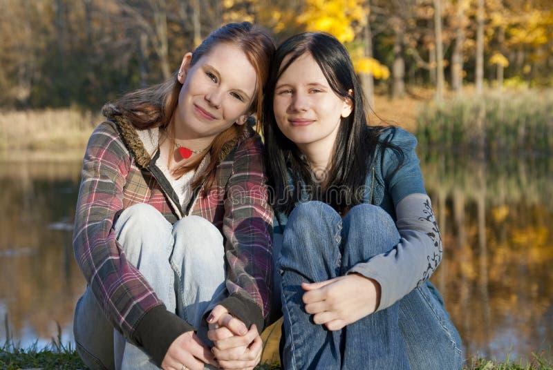 Vrienden en zusters stock foto