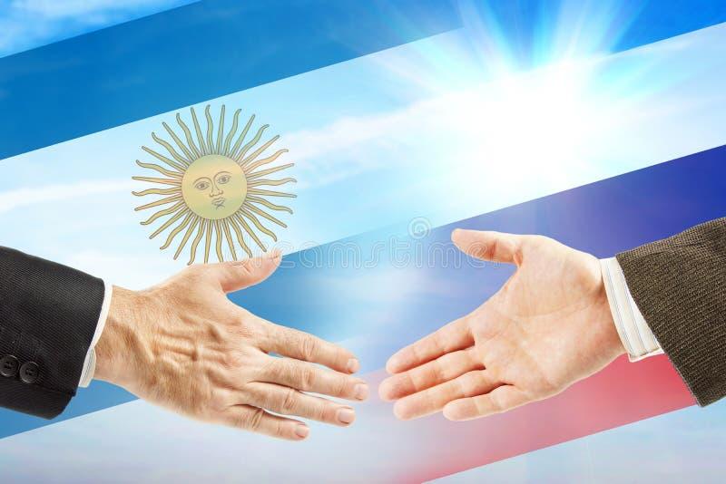 Vriendschap en samenwerking tussen Rusland en Argentinië stock fotografie