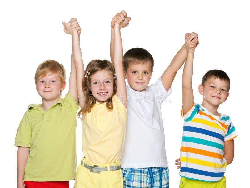 Vriendschap van vier kinderen stock afbeelding