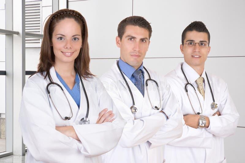 Vriendschappelijk medisch groepswerk royalty-vrije stock afbeeldingen