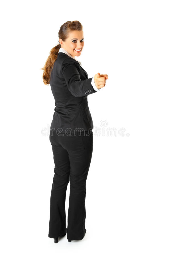 Vriendschappelijke bedrijfsvrouw die vinger richt op u stock foto's