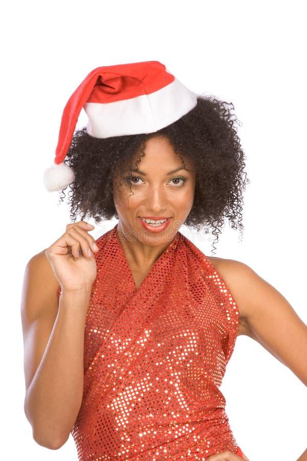 Vriendschappelijke etnische Mevr. de Kerstman die hoed draagt royalty-vrije stock fotografie