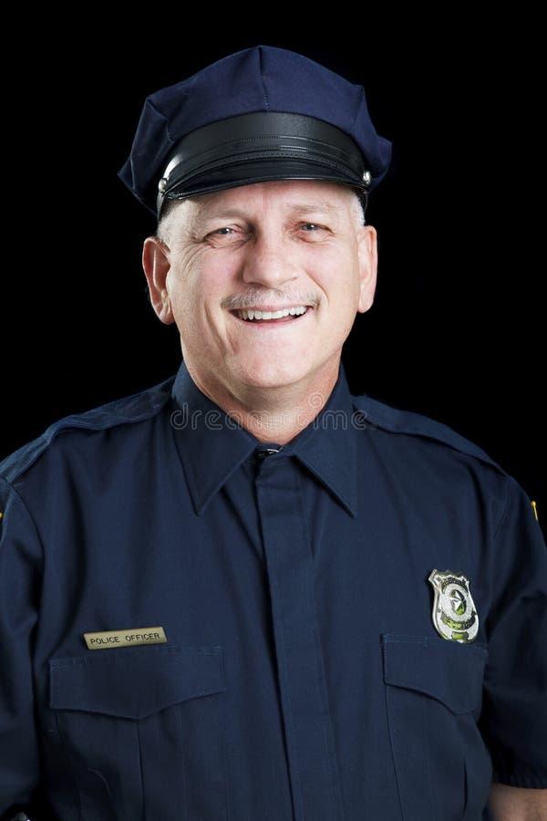Vriendschappelijke Politieagent op Zwarte stock afbeelding