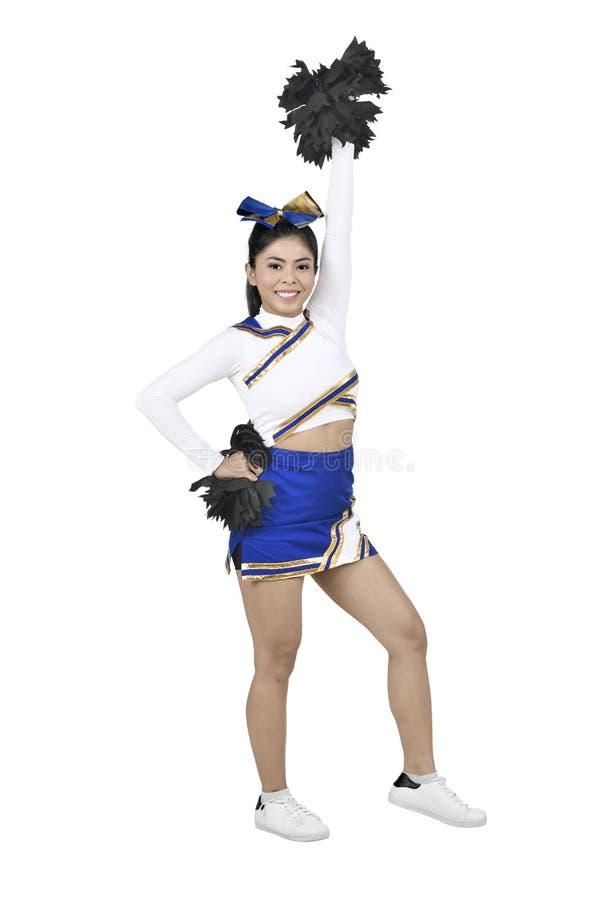 Vrij Aziatische cheerleader met wit kostuum en pom-poms stock fotografie