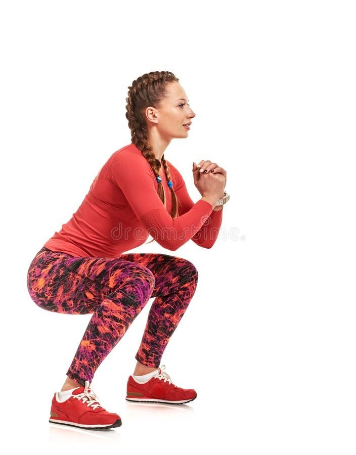Vrij het Vrouwelijke atleet squating royalty-vrije stock fotografie