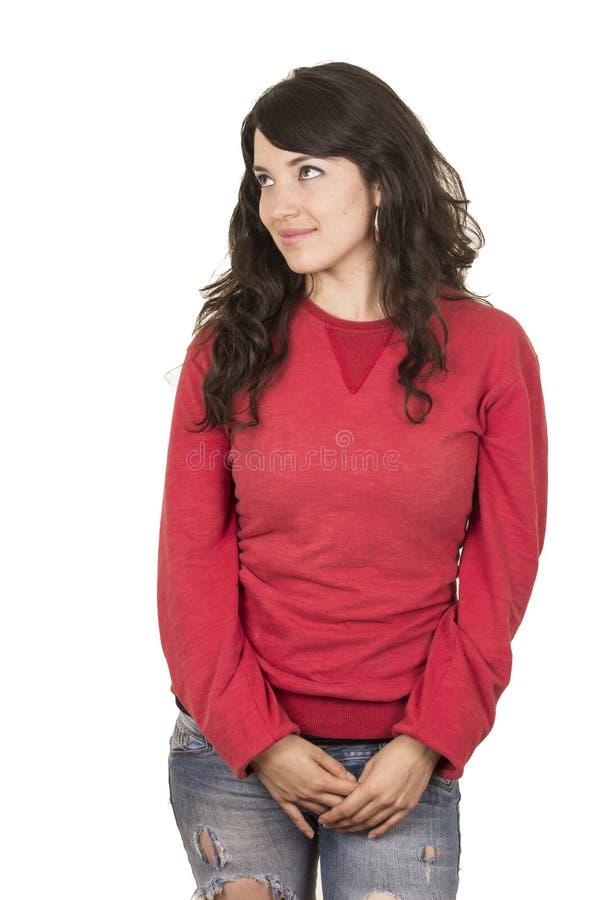 Vrij jong meisje die rode bovenkant het stellende kijken dragen royalty-vrije stock afbeelding