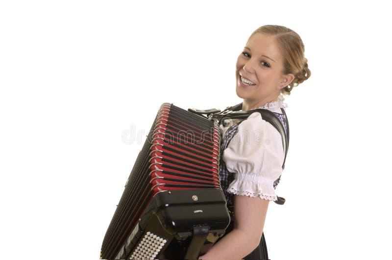 Vrij jonge drindlvrouw het spelen harmonika stock foto