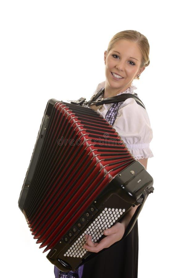 Vrij jonge drindlvrouw het spelen harmonika stock afbeeldingen
