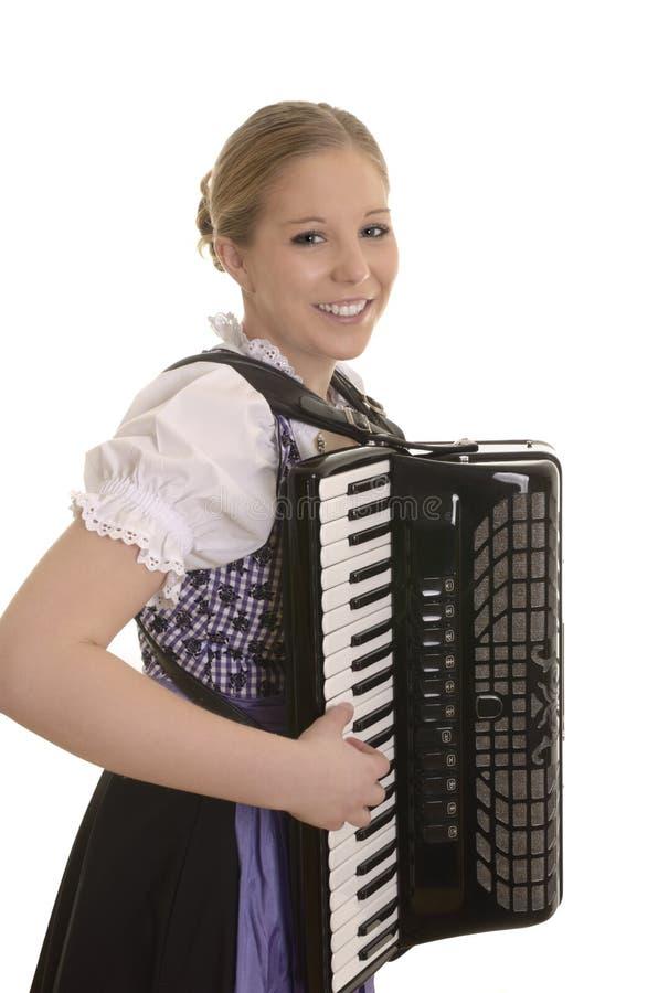 Vrij jonge drindlvrouw het spelen harmonika stock afbeelding