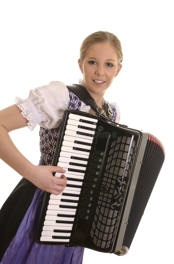 Vrij jonge drindlvrouw het spelen harmonika royalty-vrije stock afbeeldingen