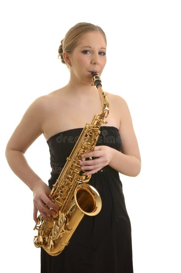 Vrij jonge vrouw het spelen saxofoon royalty-vrije stock foto