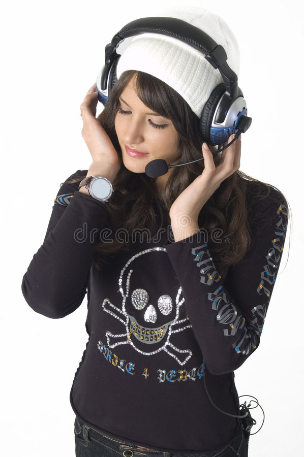Vrij jonge vrouw met hoofdtelefoons stock foto's
