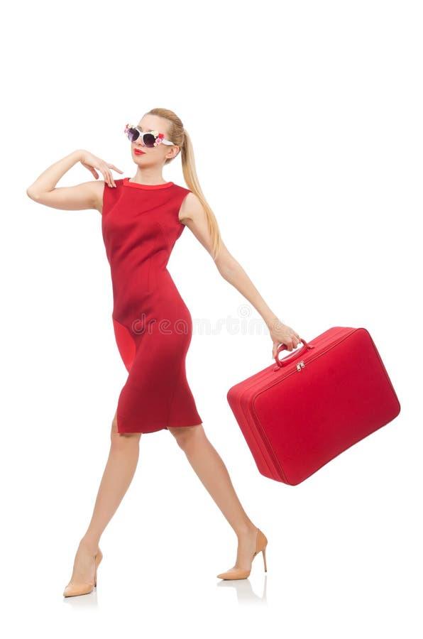 Vrij jonge vrouw in rode die kleding op wit wordt geïsoleerd royalty-vrije stock fotografie