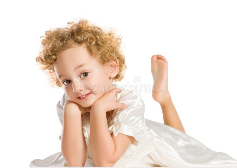 Vrij krullend blond meisje royalty-vrije stock afbeelding