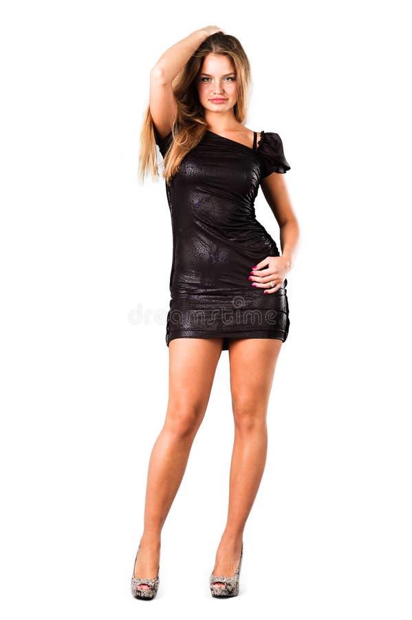 Vrij in magere zwarte kleding die op wit wordt geïsoleerd royalty-vrije stock fotografie