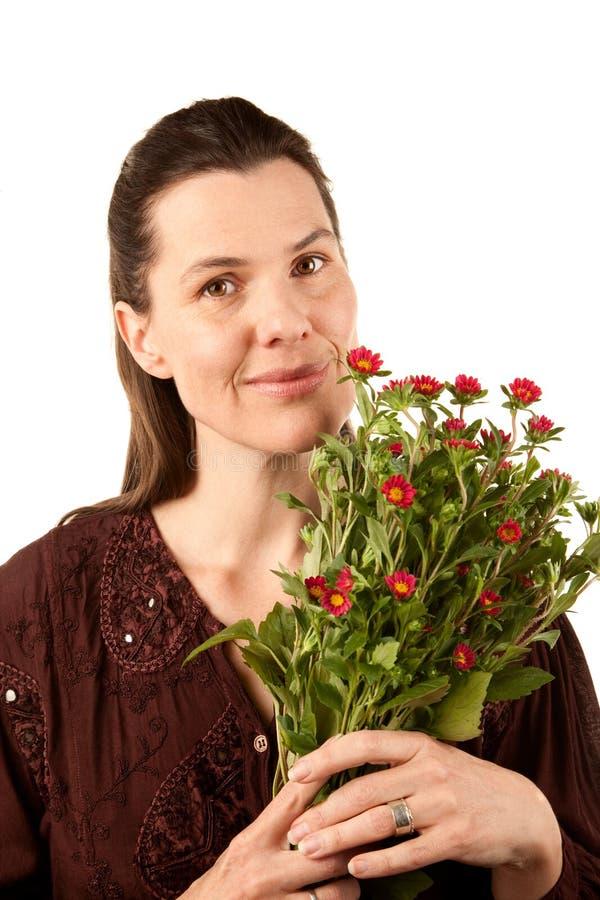 Vrij Volwassen Vrouw met Bloemen stock afbeeldingen