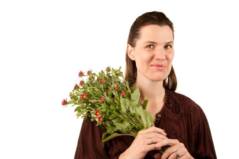 Vrij volwassen vrouw met bloemen stock foto