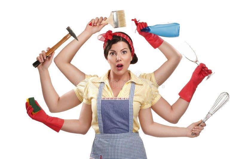 Vrij zeer bezige multitasking huisvrouw op wit royalty-vrije stock fotografie
