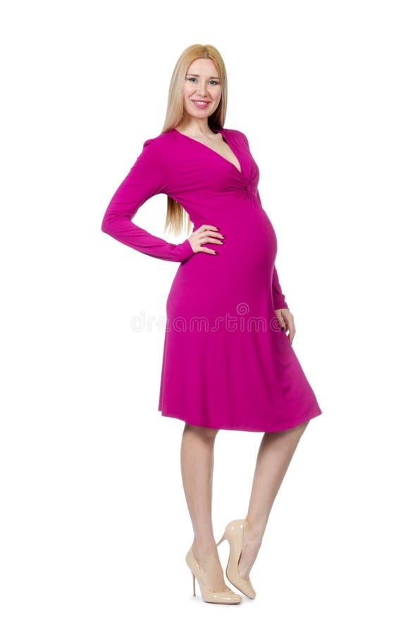 Vrij zwangere geïsoleerde vrouw in roze kleding stock foto