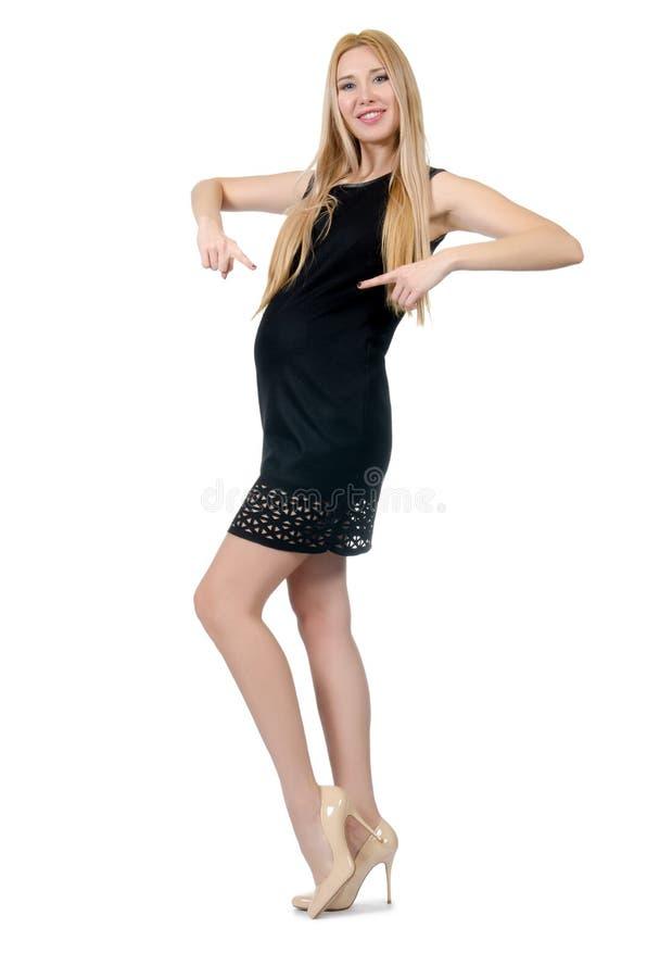 Vrij zwangere vrouw in geïsoleerde mini zwarte kleding royalty-vrije stock afbeeldingen