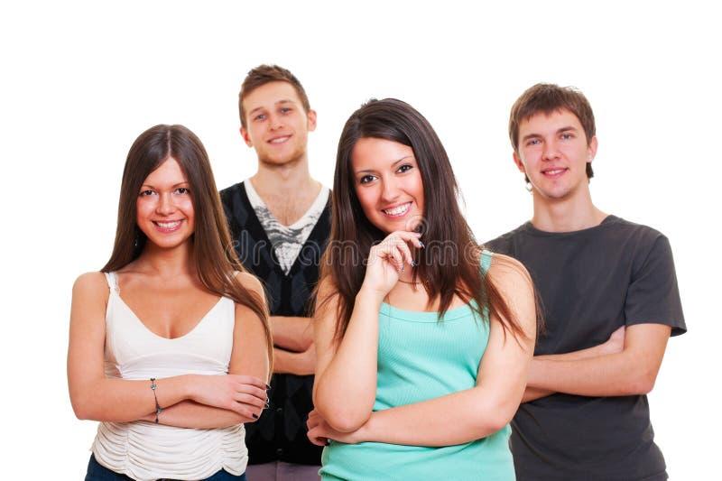 Vrolijk bedrijf van jonge mensen stock afbeelding