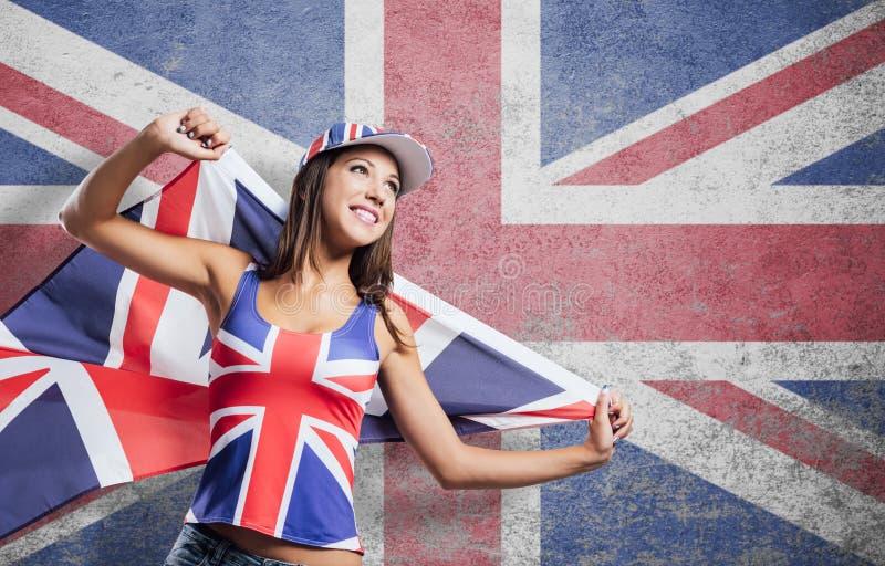Vrolijk Engels meisje met een vlag stock afbeelding
