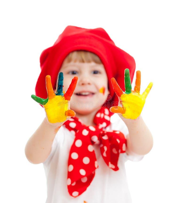 Vrolijk het meisjeskind van de kunstenaar met geschilderde handen stock afbeeldingen