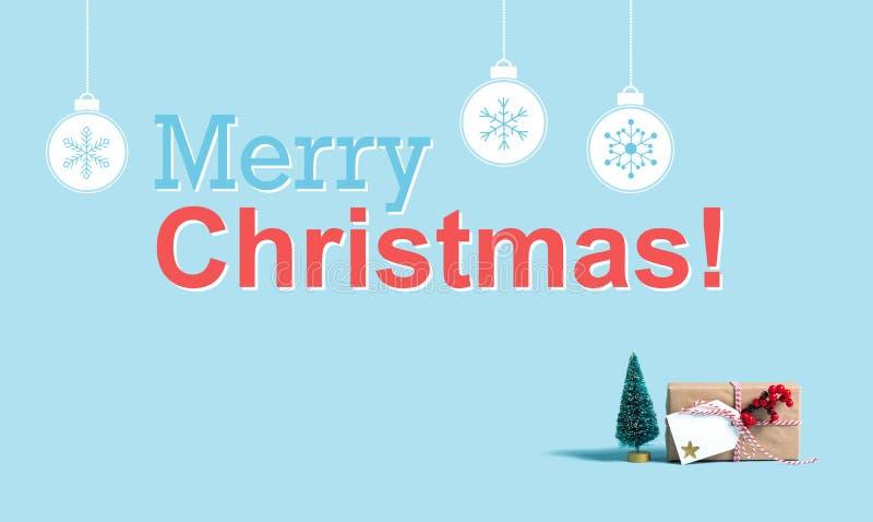 Vrolijk Kerstmisbericht met het vakje en de boom van de Kerstmisgift stock foto