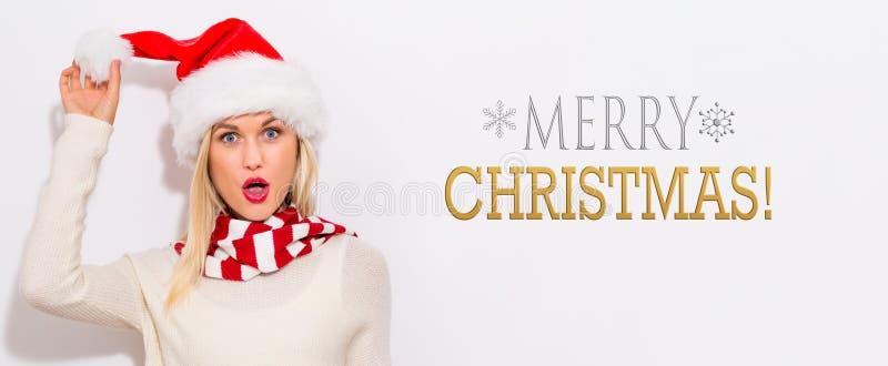 Vrolijk Kerstmisbericht met vrouw met Kerstmanhoed stock afbeeldingen