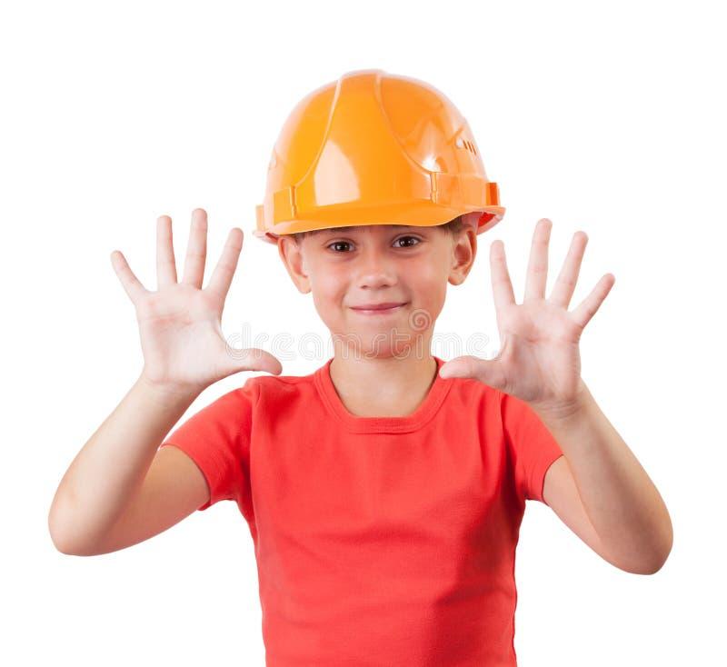 Vrolijk kind in een beschermende helm royalty-vrije stock foto