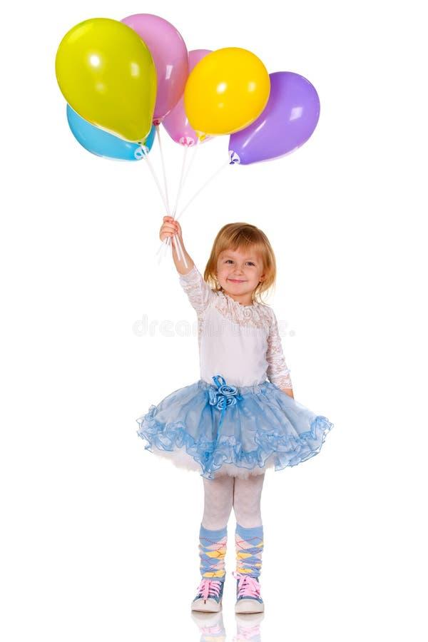 Vrolijk meisje met ballons royalty-vrije stock afbeelding
