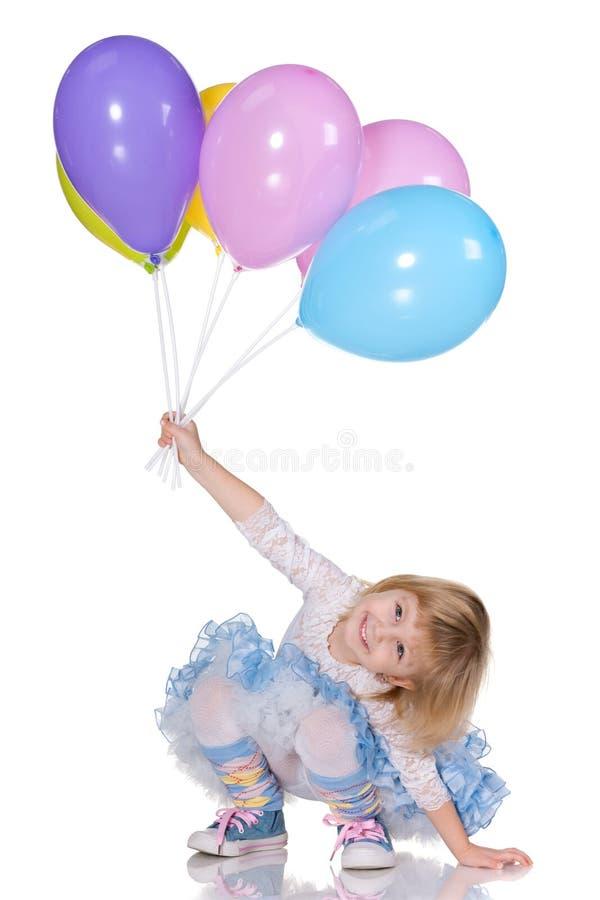 Vrolijk meisje met ballons stock afbeelding