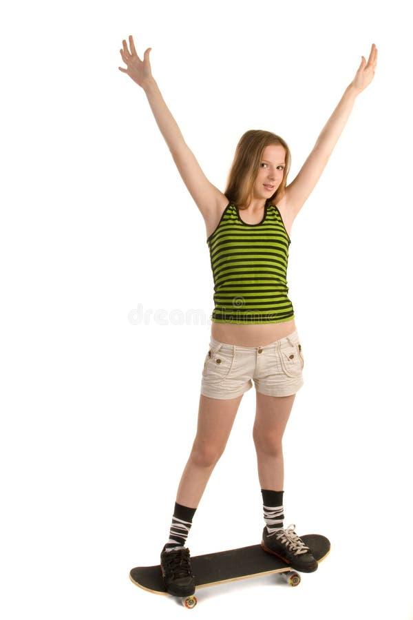 Vrolijk meisje op het skateboard royalty-vrije stock afbeelding