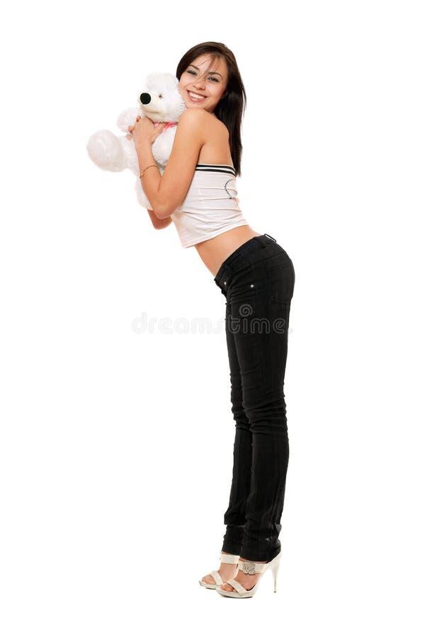 Vrolijk mooi meisje met teddybear stock afbeeldingen