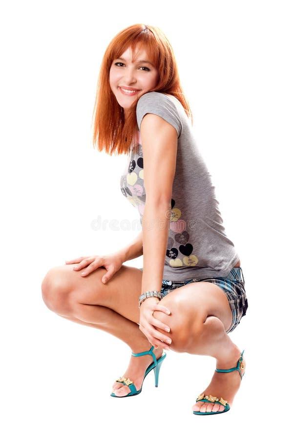 Vrolijk roodharig meisje stock afbeelding