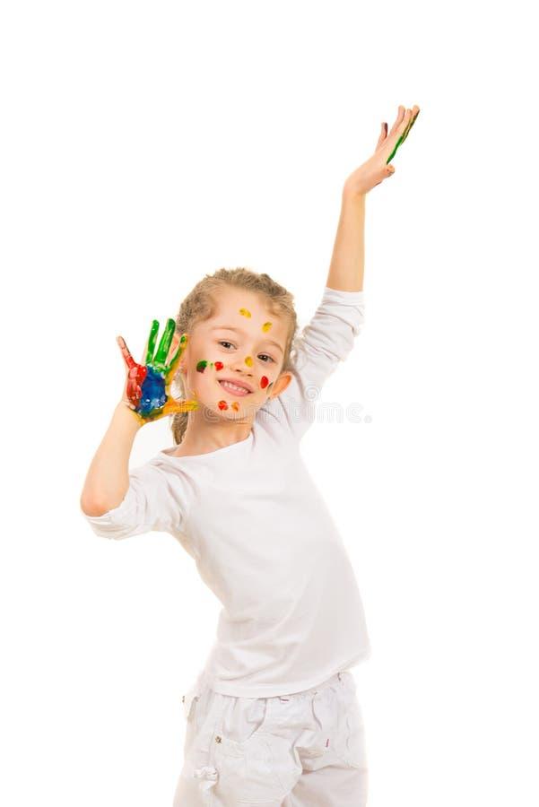 Vrolijk slordig meisje met geschilderde handen royalty-vrije stock afbeeldingen