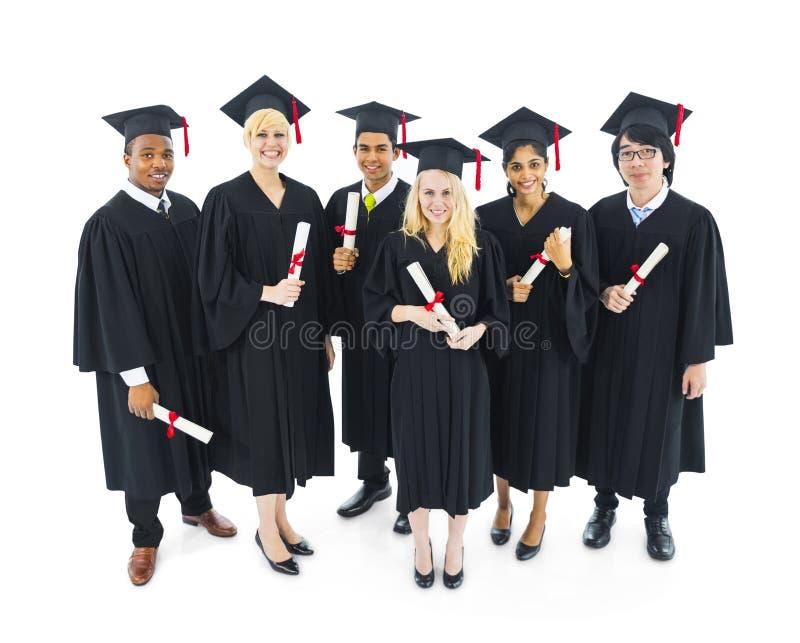 Vrolijke en Succesvolle Een diploma behalende Studenten royalty-vrije stock foto's